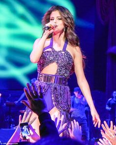 Selena Gomez performs at Staples Center in Los Angeles, California during her 'Stars Dance' Concert Tour