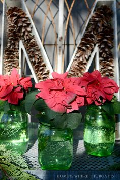 Green Heritage Ball Jars with Winter Rose Poinsettias. Directions on searing poinsettias as cut flowers to use in vases or arrangements. #jars #Christmas