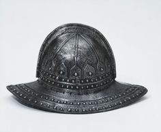 "1620 English Pikeman's helmet at the Victoria and Albert Museum, London - From the curators' comments: ""This helmet, characterised by its deep bowl and wide, slightly turned-down brim, is of a type worn by pikemen, soldiers armed with pikes who were used as a defence against cavalry. This form of helmet was popular from the first decade of the 17th century up to the Civil War of 1642-1646 and large numbers have been preserved in arsenals and armouries."""