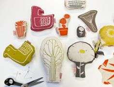 Lino print on fabric, and then make them into pin cushions.