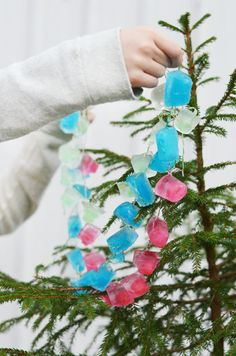 This icy cool garland is a perfect holiday craft activity for kids.