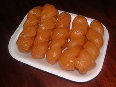 Koeksisters ... a South African dessert ... fried pastry/dough soaked in syrup and then refrigerated.  YUMMO!!