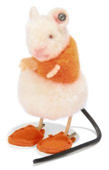 A STEIFF POM-POM MOUSE IN SLIPPERS, (4509,2), white and orange wool, red bead eyes, remains of whiskers, felt ears and hands, rubber tail, orange felt slippers and FF button, 1936-42 --2in. (5cm.) high