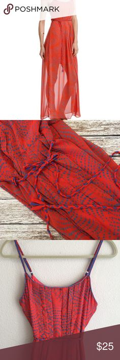 "Esley Golden Tote Dress Sheer Maxi Sundress Sad to part with this dress. I got it in my Golden Tote bag and wore it once for family photos. Color is stunning! Rope detail on waist.  Adjustable straps.  Sheer long overlay over knee length lining Rust orange/periwinkle blue Excellent used condition Size Medium  Approximate measurements  8.5"" Rise from waistline to top of bustline 18"" (flat) armpit to armpit busy (36"") 15.5 (flat) Waist (31"") 50.5"" length Esley Dresses"