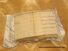 A student ID card and birth certificate sealed with desiccant inside a FoodSaver bag