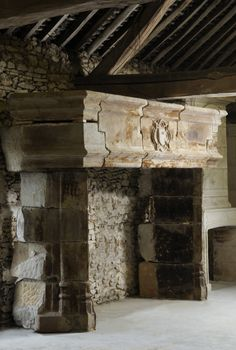 A French gothic period limestone fireplace - century---too much for my living room surely but I LOVE IT