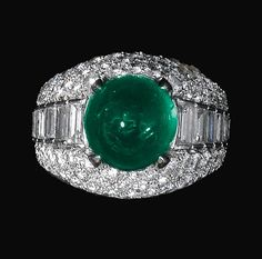 EMERALD AND DIAMOND RING, BULGARI. The bombé mount set with a cabochon emerald, brilliant-cut and baguette diamonds, size 52, signed Bulgari.