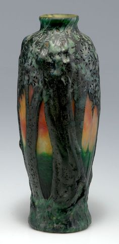 Daum Frères, Nancy. 'Paysagae, moulage en relief', 1910. Cased glass, clear, orange and yellow powder inclusions, multiple enamel fusions, mostly light- and dark green shade, mould-blown (moulage en relief). Reliefed pattern with landscape with village at dusk. Multiply etched and cut. Signed: DAUM NANCY, cross of Lorraine. H. 29 cm.     SOLD 5,000 EUR, 2011