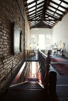 That ceiling and brick wall. Gorgeous. I would love to have this loft space.