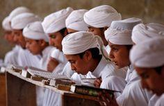 Srinagar, India: Boys read the Koran inside Markaz Al-Madrasa Al-Islamia, an Islamic seminary and orphanage, during the Muslim fasting month of Ramadan in Shadipora on the outskirts of Srinagar May 30, 2017. REUTERS/Danish Ismail </p>
