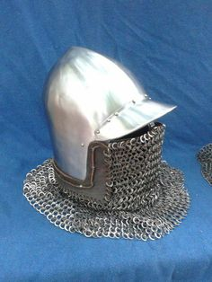 Peaked bascinet with maille aventail over concealed face and neck protection.