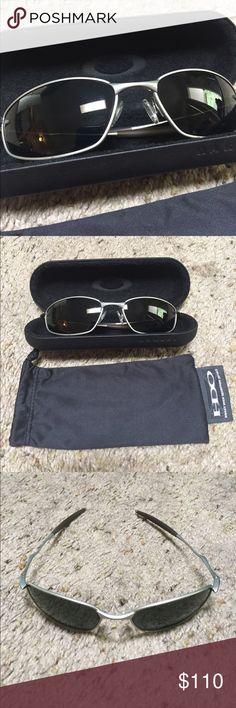 Oakley sunglasses with hard and soft case Like new silver metal frame sunglasses. Black lined hard case. Soft cleaning bag included. Oakley Accessories Sunglasses