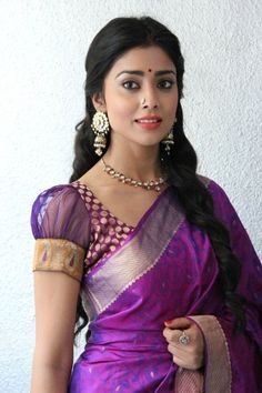 Shreya Saree adorned in a gorgeous purple saree. Combining a silk saree with a net-handed saree blouse gives it a unique touch