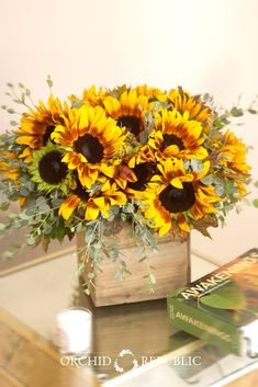 Summer's most iconic flower, these big bright sunflower blooms radiate positivity and happiness. This charming arrangement is set in a wooden box, which gives it a warm and rustic feel. Sunflower Centerpieces, Sunflower Arrangements, Floral Arrangements, Sunflower Decorations, Shower Centerpieces, Centrepieces, Sunflower Party, Sunflower Baby Showers, Wedding Bouquets