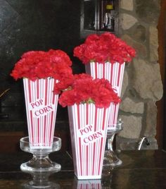 Carnation centerpieces for a kids' carnival themed party -@Becky-Henry said he wants to have a carnival birthday party..already plotting 2012