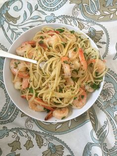 15 Minute Shrimp Linguine With Lemon Garlic Butter Sauce is a light pasta dish mixing shrimp, fresh parsley and a lemon garlic butter sauce. This dish is a great for a romantic date night, a dinner party or a light weeknight meal. // A Cedar Spoon