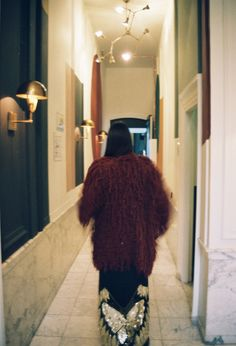Soesja is wearing our Burgendy Shag Jacket:   http://loversanddrifters.com/collections/full-moon-dirty-hearts/products/burgundy-shag-jacket