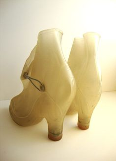 rain boots from the the 50's, to be worn over your high heel shoes