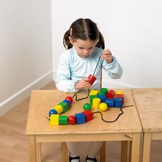 24 huge wooden beads in four vibrant colors and three distinct shapes combine with two extra-long laces for many activities. Stringing the easily grasped beads promotes hand-eye coordination, fine motor, cognitive and visual perception skills. Many learning opportunities, including, pincer grip, co-ordination, sorting, patterns.