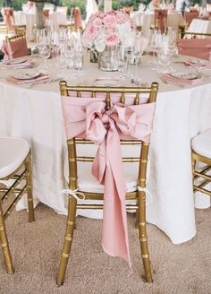 Pink bow on the back of each chair. #WeddingChairs