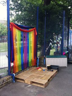 Homemade stage for the outdoor area to promote kids freedom to express themselves.