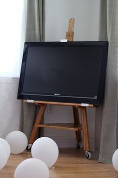 A beautiful minimalistic TV easel. Made out of Red Oak. Golden Oak stain finished with a hard wax oil for durability and to keep the timber