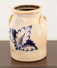 J. & E. NORTON STONEWARE CROCK.  Bennington, Vermont, late 19th century. Two gallon jug with foliate cobalt decoration and applied handles. Impressed signature