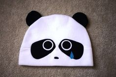 "Title:  SAD PANDA with a little blue tear drop.   The hat you receive may vary slightly from the one in the photos, due to each hat being handcrafted.          Each hat, measuring approximately 23"" ar"