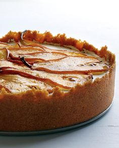 Maple syrup not only flavors this luscious cheesecake, but it also is brushed on thinly sliced pears that are broiled to create a very unique decoration atop this festive dessert.