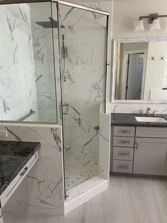 """This recent luxury bathroom remodel definitely does not disappoint. Air massage soaking tub, spacious walk-in shower designed around his and her showering needs, stunning quartz slab tops, and the 10"""" x 40"""" plank flooring all come together beautifully. Are you inspired to remodel? #twdaz #bathroomdesign #bathroomremodel #remodeling #phoenixcontractor Quartz Slab, Walk In Shower Designs, Plank Flooring, Dream Bathrooms, Remodels, Building Design, Home Remodeling, Tub, Massage"""