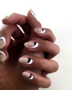 Try this monochrome look by painting your half moons black, then add a swooping splash of white to one side of the nail. Check out more insanely gorgeous cold winter nail art ideas!