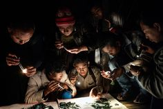 Jade traders use flashlights to assess the quality of jade being sold outside the Mandalay Jade Market in Myanmar on Jan. 21. Adam Dean—Panos for TIME