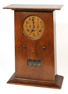 """L. & J.G. STICKLEY MANTLE CLOCK - In oak with original finish in working order with engraved copper dial, by the Stickley Corporation, 16 x 6 x 22""""high."""