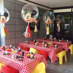 Dancing Mickey Mouse tassel balloon centrepieces for Isaac's 1st birthday party. Kids chairs by @tiny_tots_toy_hire #partysplendour…