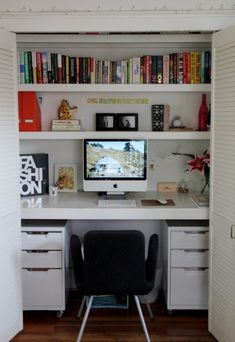Symmetrical White Closet Office. DIY a closer into a small office space. This is a good example that has. Good use of space without feeling too cramped