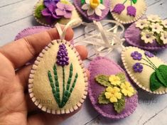 Felt Easter decoration – purple lilac felt eggs with spring flowers including primroses, violet flowers, grape hydrangea, tulips, daffodils and other flowers. Listing is for 8 ornaments: & Easter Egg Crafts, Easter Eggs, Easter Decor, Felt Crafts Patterns, Felt Gifts, Felted Wool Crafts, Diy Ostern, Felt Embroidery, Felt Decorations
