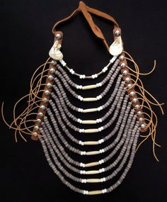 Nez Perce style necklace: white and light purple trade neck glass beads, solid metal cone beads, leather, bone, and teardrop abalone shells.  $150 (tax & shipping to anywhere in Canada included)