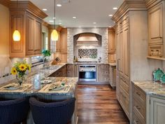 Browse pictures of beautiful kitchen designs at HGTV Remodels and get expert advice on one-wall, galley, L-shape, horseshoe, peninsula and island kitchen layouts.