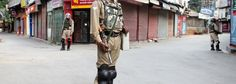 Para-military personnel guard Court Road in Lal Chowk area of Srinagar on Wednesday.Excelsior/Shakeel