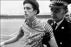 Magnum Photos - Ian Berry G. Football hooligan being escorted from the pitch after disrupting the match. Football Casuals, Football Soccer, Football Players, Ian Berry, Youth Culture, Magnum Photos, Look At You, Way Of Life, Behance