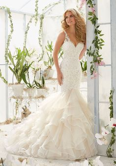 Wedding Dresses and Bridal Gowns by Morilee designed by Madeline Gardner. Vintage Pearl and Crystal Beading on Alencon Lace Flounced Mermaid Wedding Dress