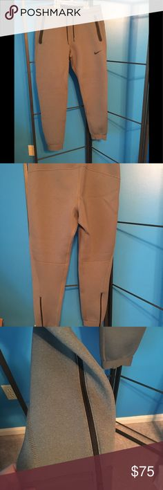 Nike sweat pants NWOT to big & too late to return Christmas gift my husband tells me now are too big! Tags off but never worn, except to try on🤗 Nike style, comfort and quality! Deep zippered pockets! Zippers at ankles! Color is shade of grey in 3rd picture 🏃🏽♂️ Nike Pants Sweatpants & Joggers