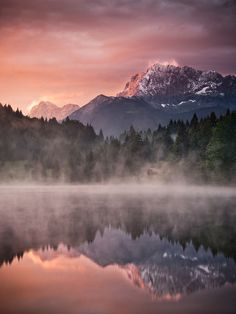 Misty Lake with Beautiful Mountain Backrop