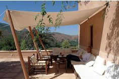 Simple lean-to shading via a canvas awning.  Kasbah Bab Outika Hotel, view of Atlas Mnts, Morocco