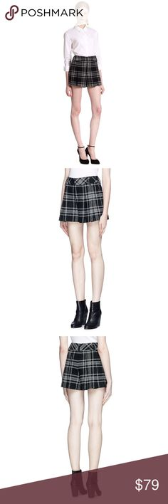 Alice + Olivia Plaid Pleat High Waist Shorts Featuring crisp plaid with allover pleating for voluminous movement, these chic high-waist shorts by alice + olivia tone down the classic vibrant pattern with monochromatic allure that collides feminine chic and masculine cool for a glam effect. * Black and white wool-blend plaid.  * Pleated hem.  * Zip fly with hook-and-bar secure, and belt loops. * 42% Wool, 16% Polyamide, 16% Polynosic, 16% Polyester, 8% Silk, 2% Elastane. * Lined.  * Rise…