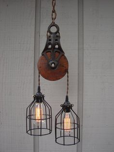 Industrial Pulley Pendant Light by BenclifDesigns on Etsy. This would be cute in the attic when we finish it