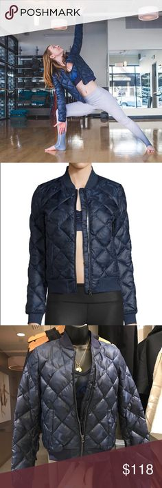 Alo Bomber Jacket The street-style approved Idol Bomber Jacket is an updated bomber with sporty details like a cadet collar and sleek diamond down-filled quilting. A lightweight finish and ribbed details give it right-now appeal. Wear it layered over your favorite pieces for morning and evening. In Navy Camo print. ALO Yoga Jackets & Coats Puffers