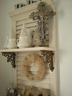 Take an old shutter, add some shelves, and accessorize. I love this idea!!! If I added another pretty support on the top of each shelf, it would make an awesome bookshelf and the supports would act as bookends. I have to try this!