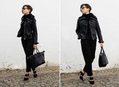 Shop this look on Lookastic:  http://lookastic.com/women/looks/black-turtleneck-black-tote-bag-black-heeled-sandals-black-biker-jacket/8570  — Black Turtleneck  — Black Leather Tote Bag  — Black Suede Heeled Sandals  — Black Leather Biker Jacket