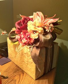 Gift wrapping idea - Over embellish  a gift box for drama. Use ribbon and lots if flowers. Just stay within a small color palette.  Zsazsa Bellagio #giftwrapping  #dlowers #emballagecdeau